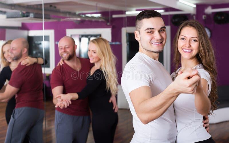 Couples enjoying of partner dance royalty free stock photography