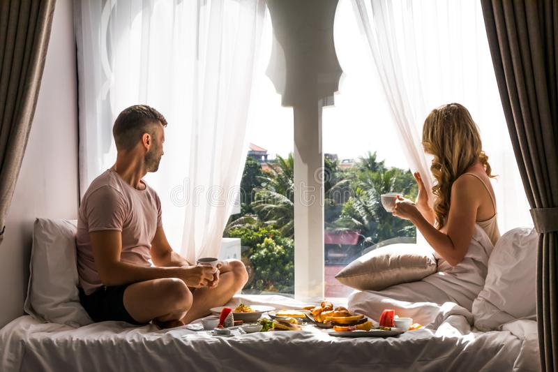 Couples Exotic Travel Lifestyle Breakfast Honeymoon Vacation. A couple is enjoying a luxury breakfast at an exotic hotel while traveling on vacation. A beautiful stock images