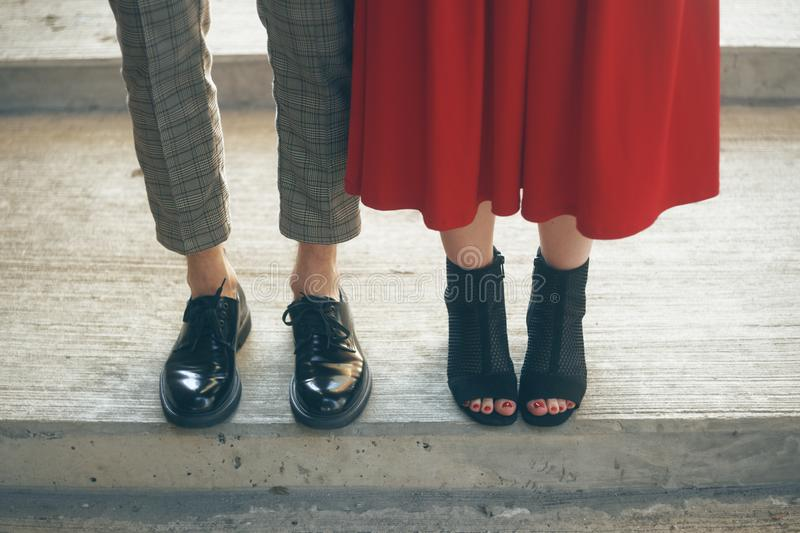 Couples foots stay at the street, stylish trendy outfit. The most beautiful pair of shoes. Legs of a young couple in shoes royalty free stock photos