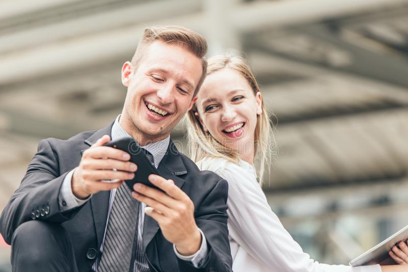 Couples friend, business men and women are interested in looking at mobile screens happily smile stock photos