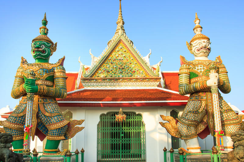 Couples of giant in front of buddha temple church stock image