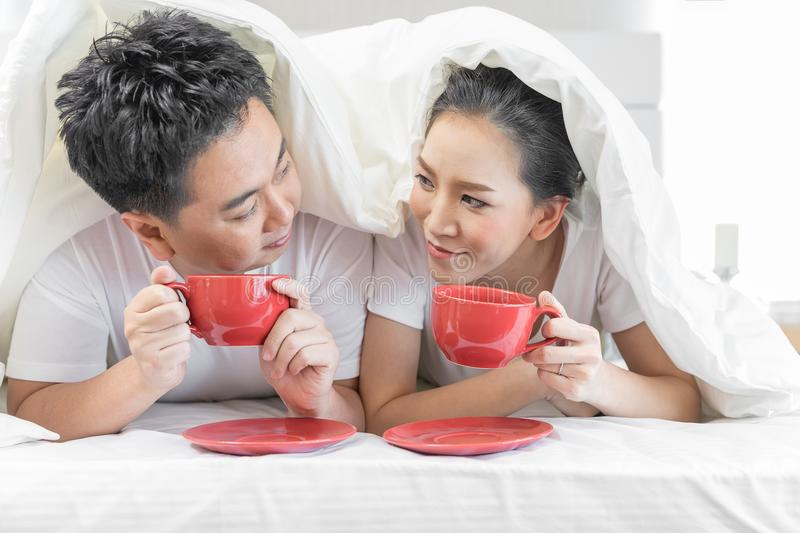 Couples having breakfast on bed stock photos