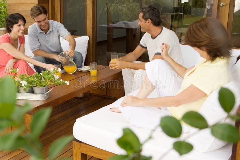 Couples having orange juice royalty free stock images
