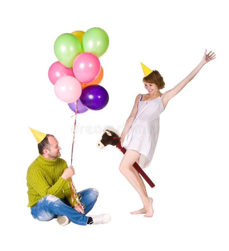 Couples heureux célébrant des vacances images libres de droits