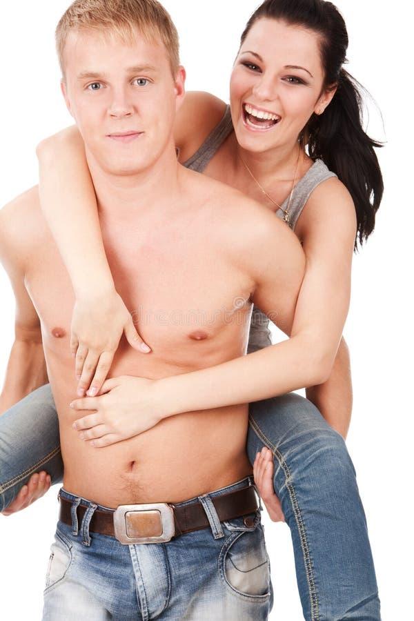 Couples heureux d'années de l'adolescence caressant photos stock