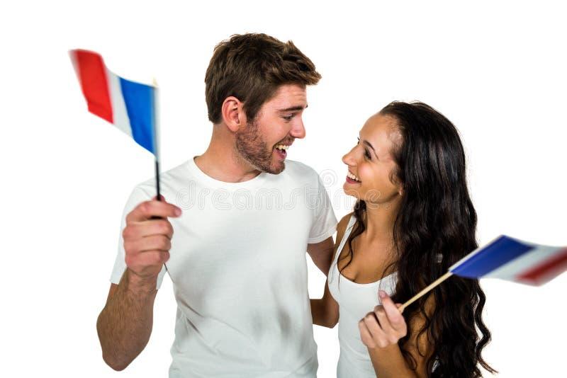 Couples heureux tenant le drapeau français photographie stock