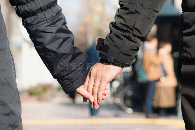 Couples holding hands in the winter season stock photography