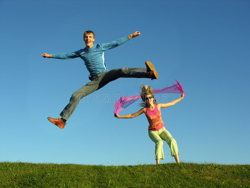 Download Couples jump on grass stock image. Image of grass, girl - 221203