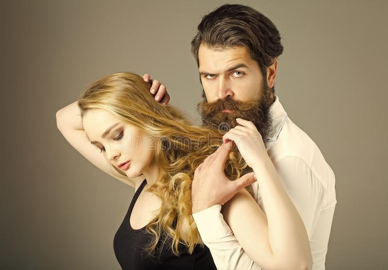 Couples in love. Couple in love with trendy hairstyle hug on grey background stock image