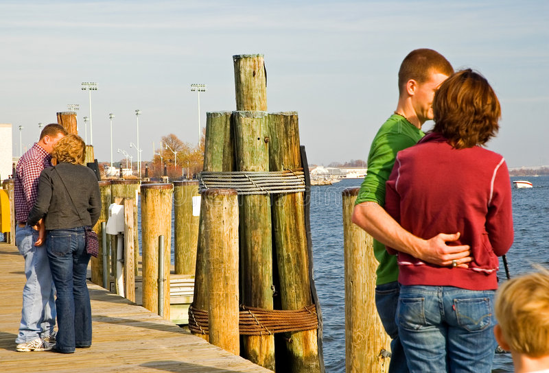 Couples in love on dock. Couples in love on a waterfront dock royalty free stock photos