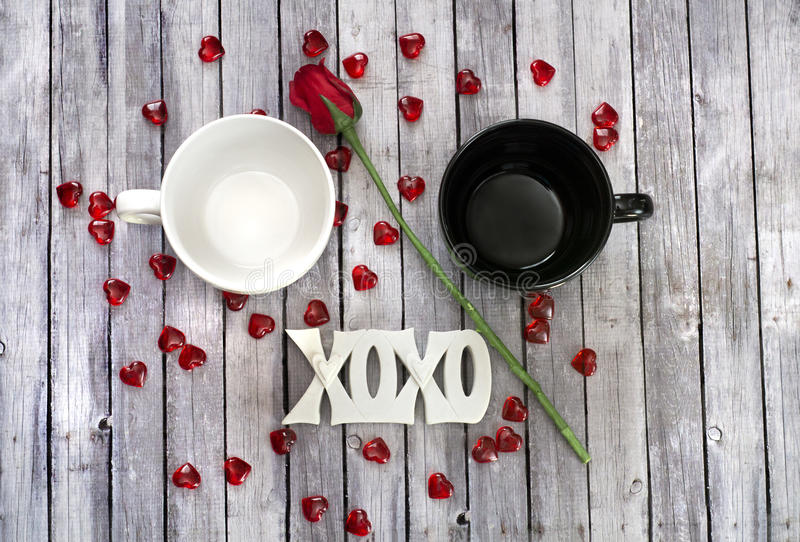 Couples mug on wood table with rose. Couples mugs on wood table ready for valentines day with rose stock image