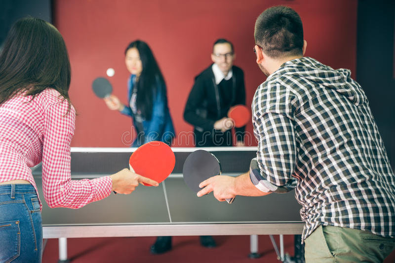 Couples playing ping pong stock images