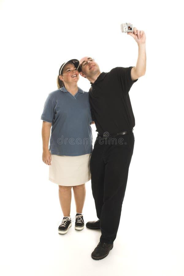 Couples prenant des photos image stock