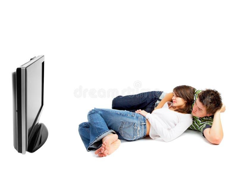 Couples regardant la TV photographie stock