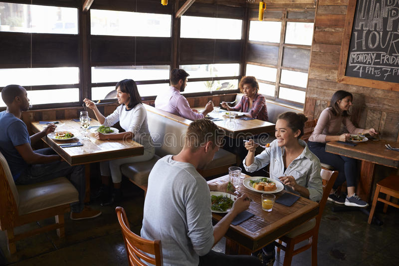 Couples relaxing over lunch in a restaurant, elevated view stock images