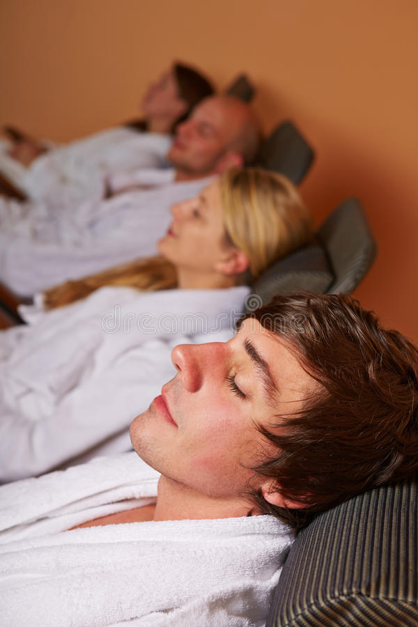Couples resting in relaxation room royalty free stock photography