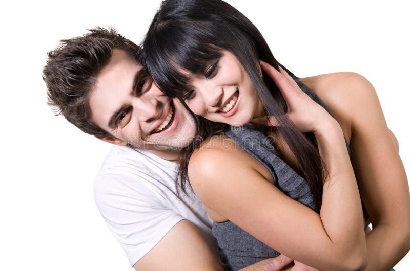Couples riants (avec le chemin de découpage) photographie stock
