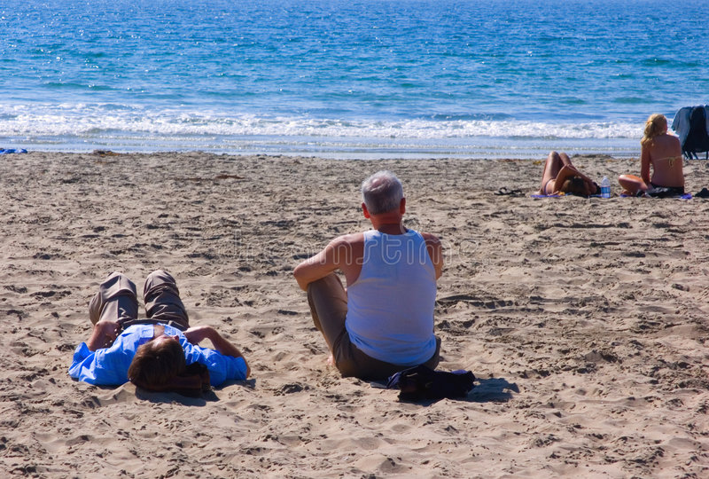 Download Couples on sandy beach stock photo. Image of caucasian - 1409154