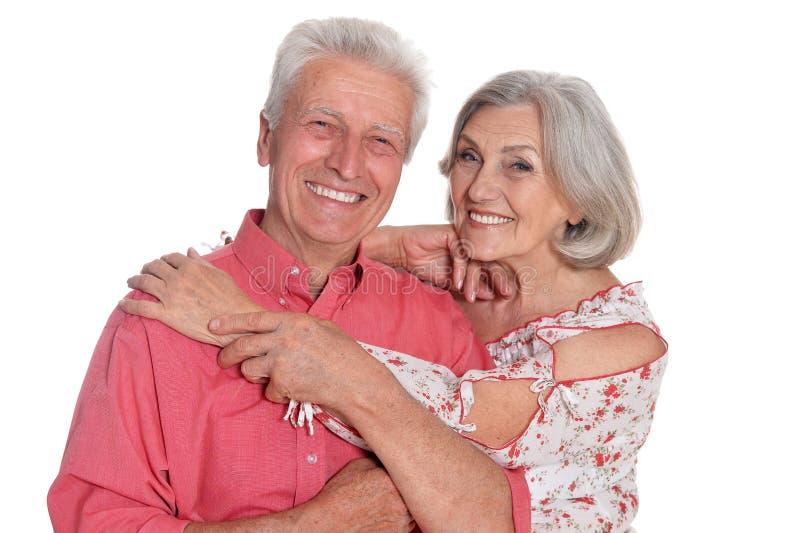 Couples supérieurs heureux d'isolement sur le fond blanc photo stock