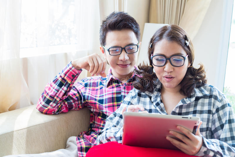 Couples with tablet royalty free stock photos