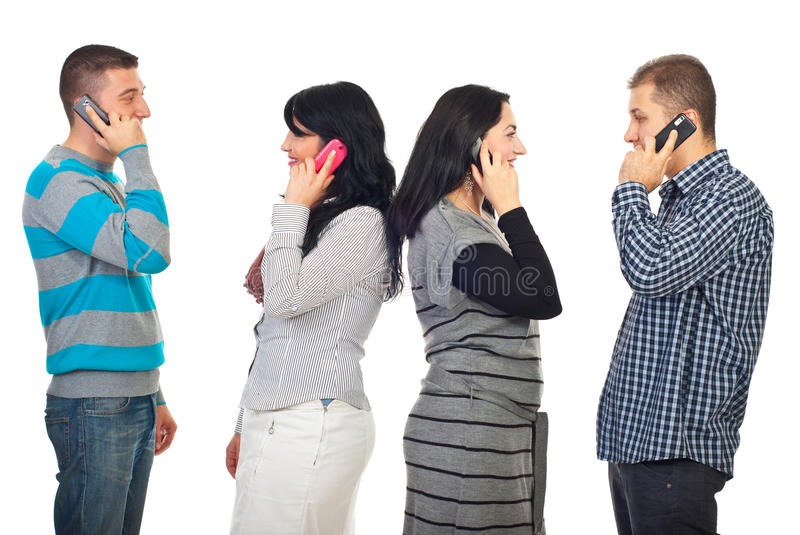 Couples talking by phone mobiles royalty free stock photography