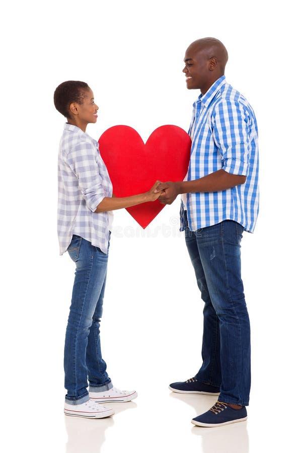 Couples tenant le coeur photographie stock