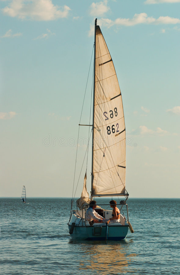Couples under sail royalty free stock photography