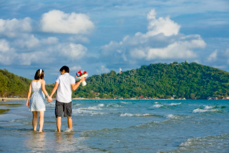 Couples walking beach royalty free stock images