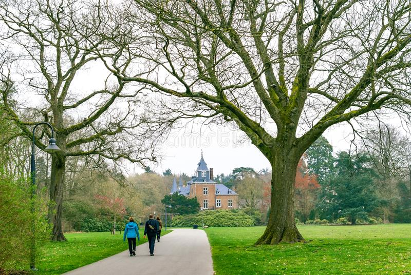 Couples walking in a park on a cloudy spring day royalty free stock images