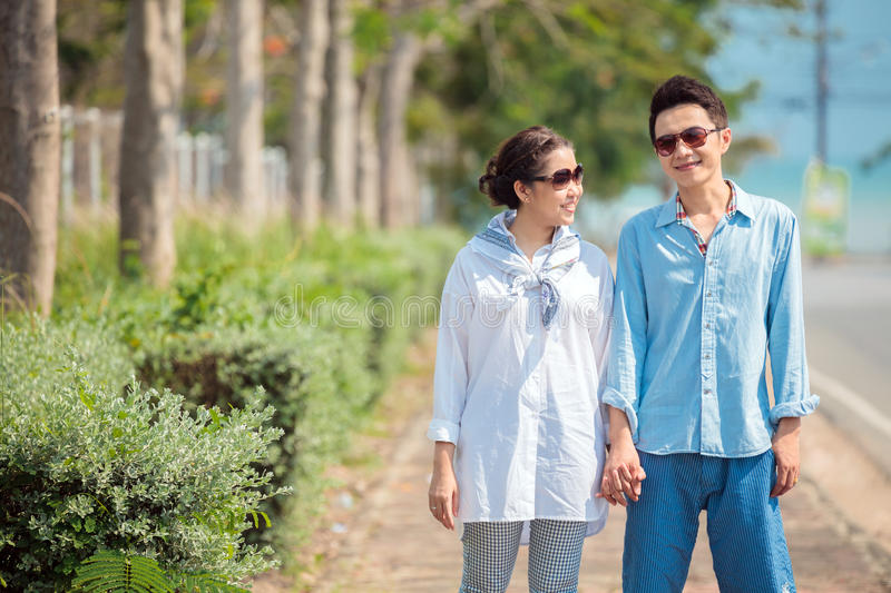 Couples walking together stock photography