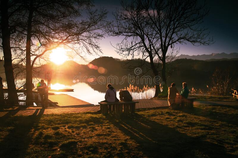 Couples welcoming the sunrise stock images