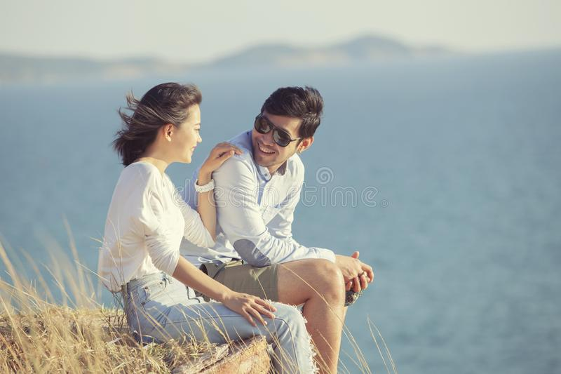 Couples of younger asian man and woman relaxing with happiness o royalty free stock photo