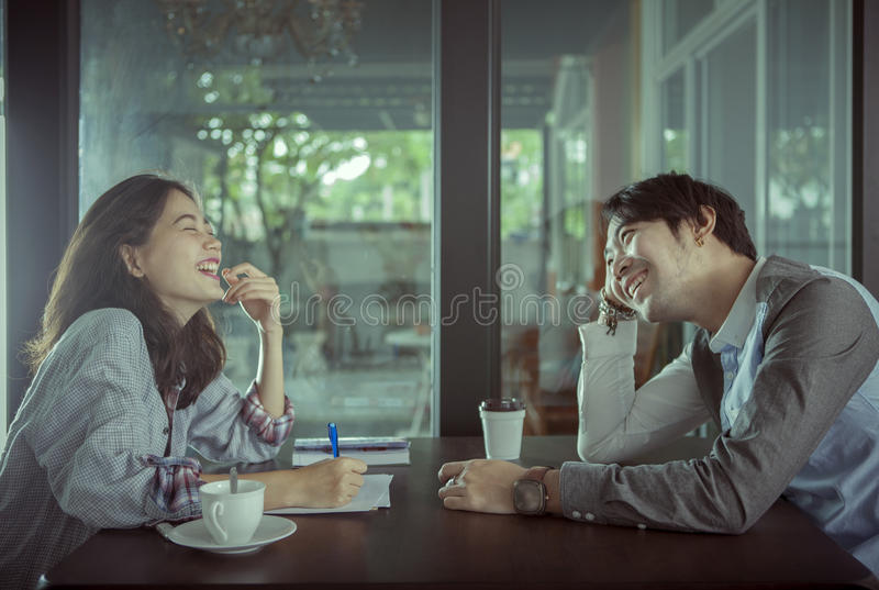 Couples of younger asian man and woman relaxing with hot coffee stock photos