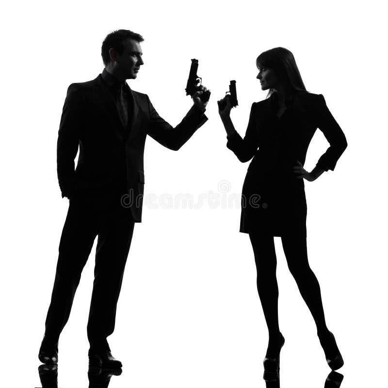 Couplez la silhouette révélatrice de criminel d'agent secret d'homme de femme images libres de droits