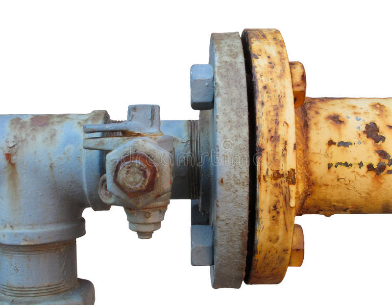 Coupling joining two rusty pipes isolated. Coupling joining two old, rusty, and weathered blue and yellows metal gas line pipes, with a shut-off valve. Isolated stock photography