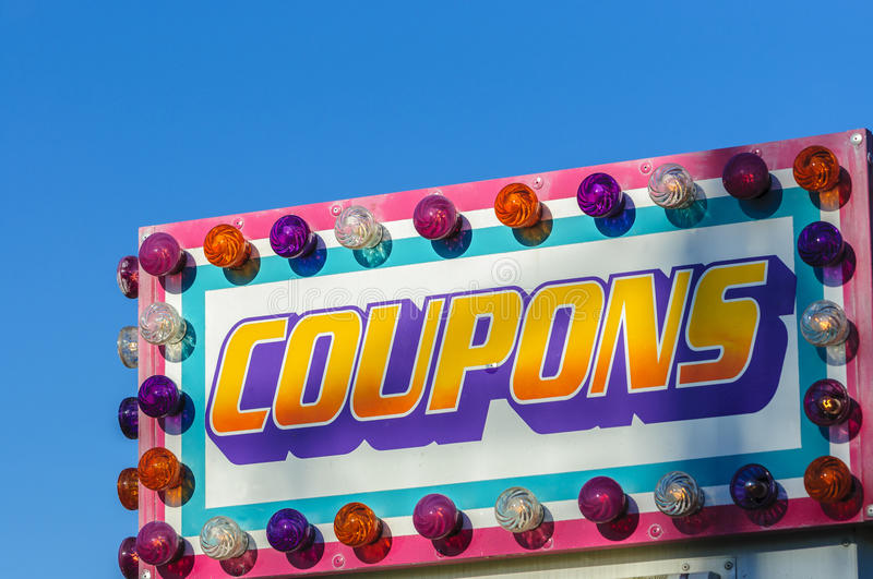 Coupon sign. Age surrounded with colorful bulb royalty free stock photo