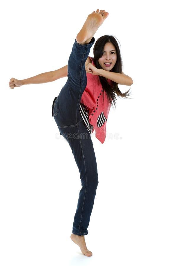 Coups de pied de femme photographie stock