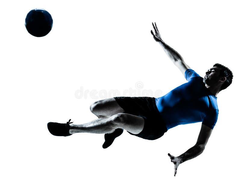 Coups de pied de vol de joueur de football du football d'homme photo libre de droits