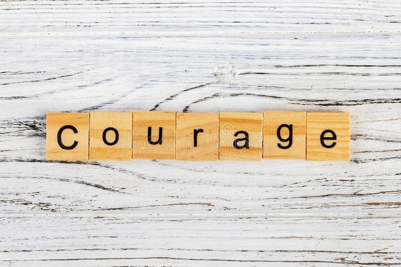 COURAGE word made with wooden blocks concept.  royalty free stock photography