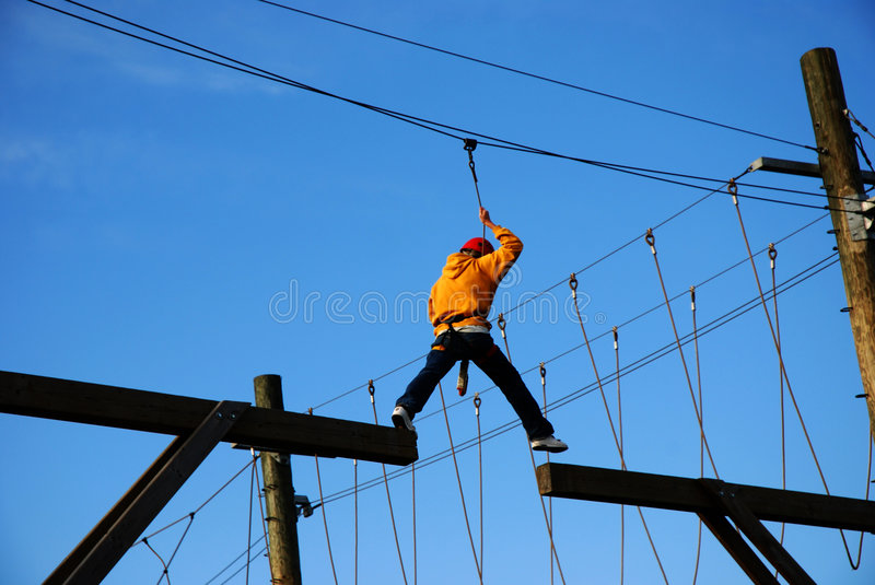 Courageous boy taking a big risky step royalty free stock photo