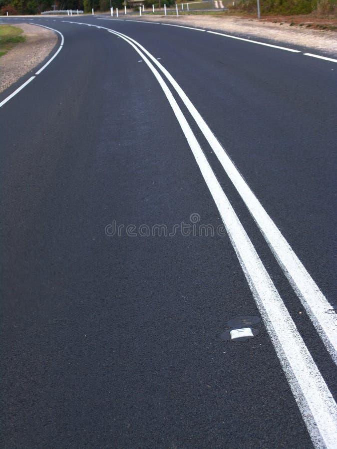 Courbe de route photos stock