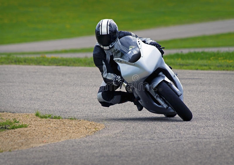 Coureur de moto image stock