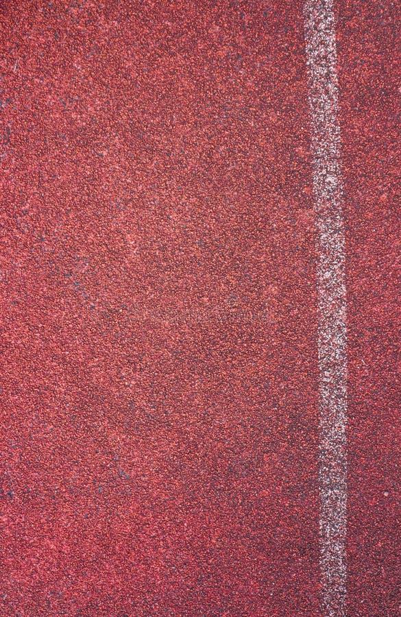 Courez la voie de course et la ligne blanche de courbe image stock
