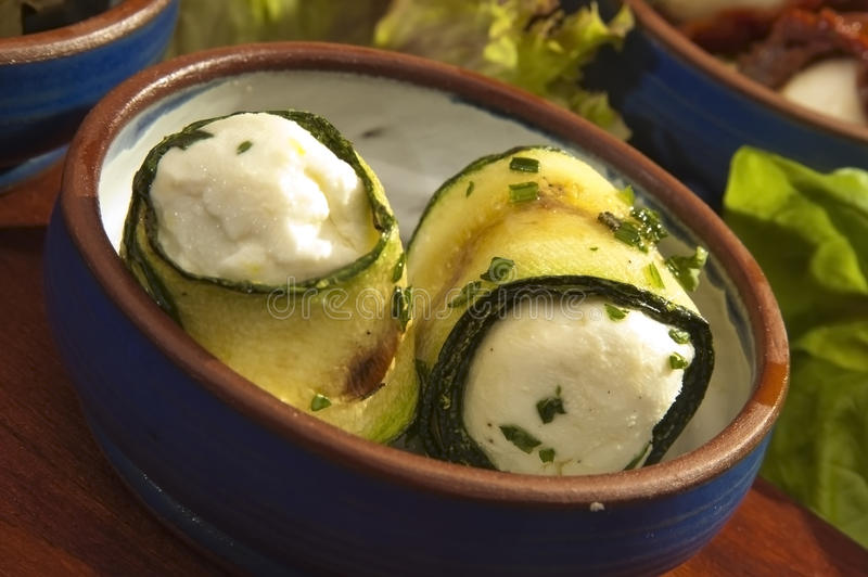 Courgette filled by the fetta cheese royalty free stock images