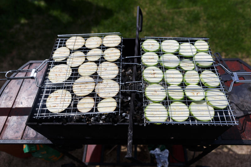 Courgettes and aubergines on barbecue stock photos