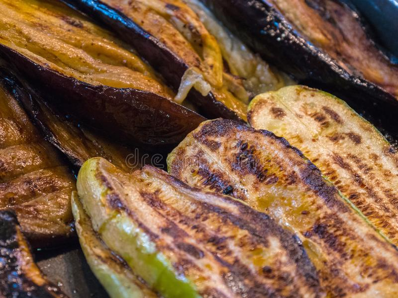 Courgettes, aubergines grilled closeup background stock images