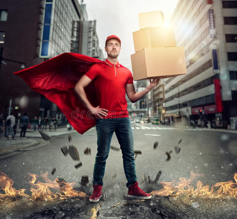 Courier acts like a powerful superhero in a city with skyscrapers. Concept of success and guarantee on shipment stock photography