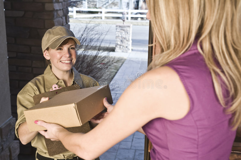Courier delivering package royalty free stock photo