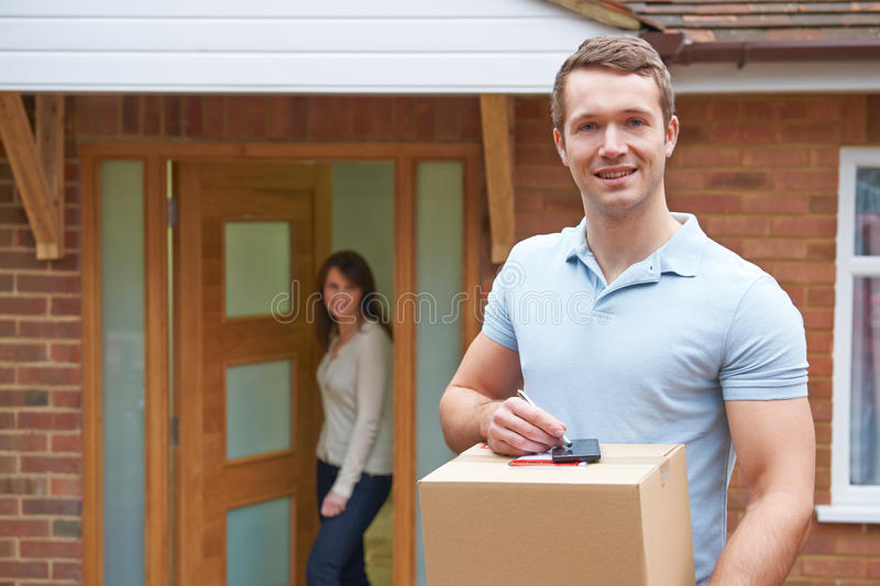 Courier Delivering Package To Domestic House. Courier Delivers Package To Domestic House royalty free stock image