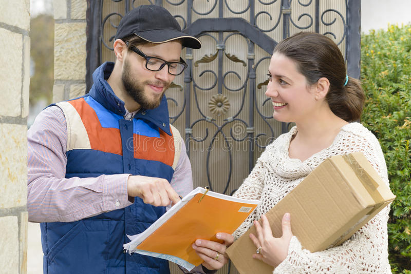 Courier Delivering a Package. To a happy woman stock images